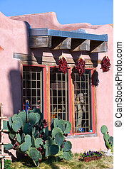 Adobe house in historical Albuquerque - Chili pepper hanging...