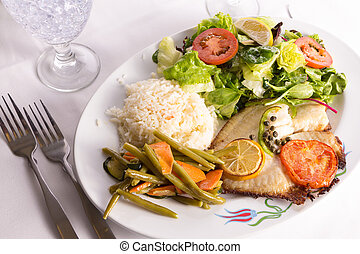 Tilapia fish cooked with capers, lemon and tomatoes and...