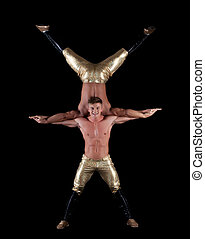 Pair of young muscular half-naked acrobats