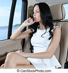 Nice trip - A gorgeous young Caucasian woman in a white...