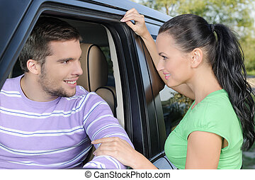 Please, drive safe! - Attractive young woman holding the...