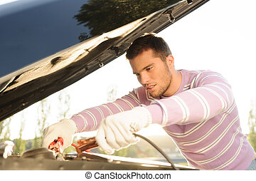I know how to fix it! - Handsome young man fixing the car...