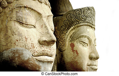 Ancient Faces - Close up of two ancient stone Buddhas