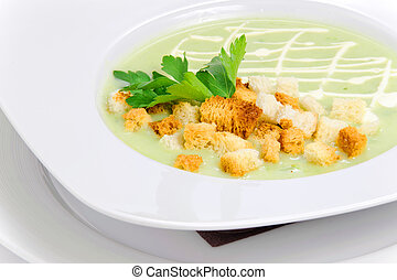 Green soup with croutons