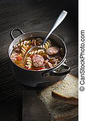 Sausage stew - Hot stew with sausage, beans and pasta on...