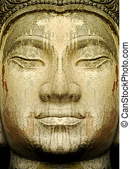 Stone Ancients - Close up of an ancient stone Buddha