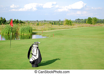 white golf bag on golf course