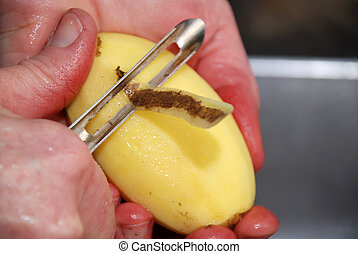 peal potato - hands peal potato peel