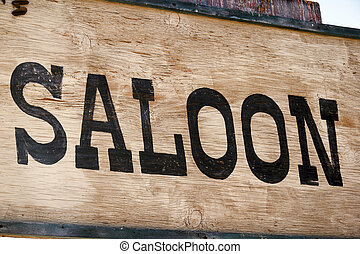 Saloon - Weathered hand-painted sign on old west ghost town