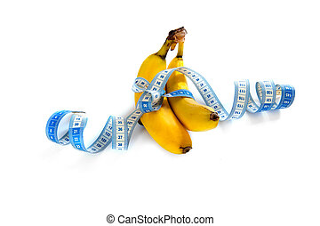 tape-measure - a banana with a tape-measure on a white...