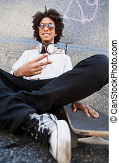 Teenager. African descent teenager gesturing and smiling at...