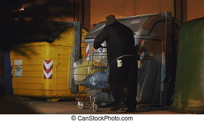 homeless looking for food - cause the economic crises a...