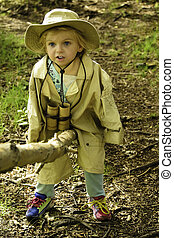 Log see saw - A young girl in the woods on a log