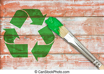 Recycle symbol painted on the wooden wall - Paintbrush and...