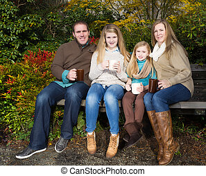 Family takes a break from thier walk in the park