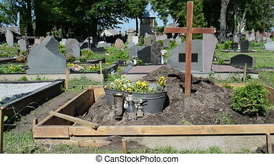 fresh grave cemetery soil - Panorama of freshly made grave...