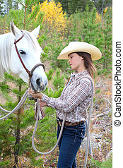 Horse and Human - Beautiful brunette cowgirl with her horse...
