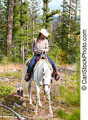 Horseback Riding - Beautiful brunette cowgirl with her horse...