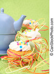 Tea Party with three cupcakes and a blue teapot