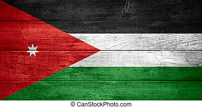 flag of Jordan or Jordanian banner on wooden background