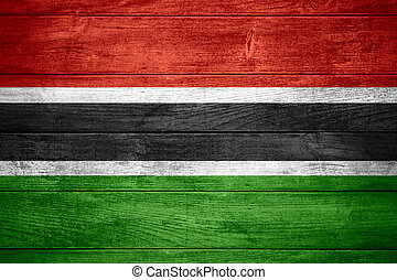 flag of Gambia or banner on wooden background