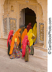 Colorful Tourists - Indian women in bright orange saris in...