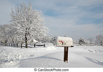 Snow Covered Landscape - Snow covered mailbox against a cold...