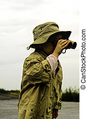 Bird watching - A young girl using her binoculars to watch...