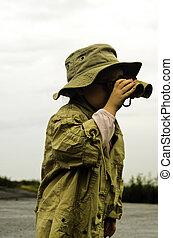 Bird watching - A young girl using her binoculars to watch...