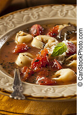 Rustic Homemade Tortellini Soup with Tomato, Basil, and...