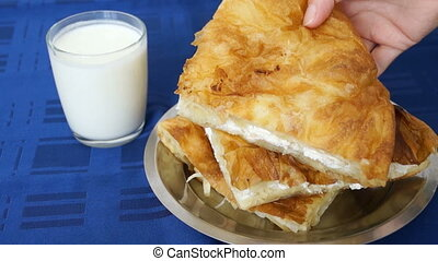 Burek (b?rek) with cheese and yogurt