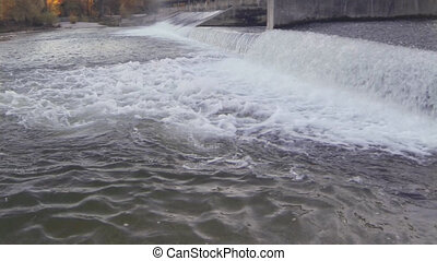 waterfall - Fast flowing water at a dam in a river