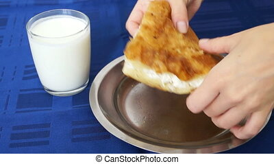 Eating burek brek with cheese and drinking yogurt