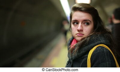 Woman waiting metro at station