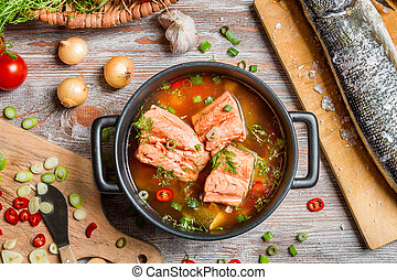 Closeup of fish soup with salmon and dill