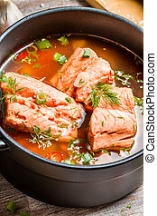 Spicy fish soup made of salmon and spiced with dill