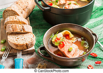 Closeup of fish soup with freshly caught salmon