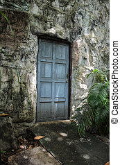 old wood door in the stone wall