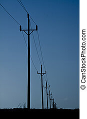 telegraph poles silhouette with blue sky background