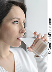 Drinking cool water. Beautiful middle-aged woman drinking...