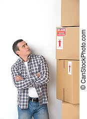 House moving. Thoughtful middle-aged man standing near the...