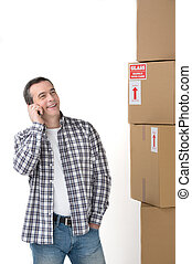 House moving. Cheerful middle-aged man standing near the...
