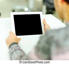 Man holding digital tablet computer
