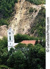 Unitarian church against gold mine - Rosia Montana....