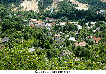 Gold mine against village - Rosia Montana, Romania. The...