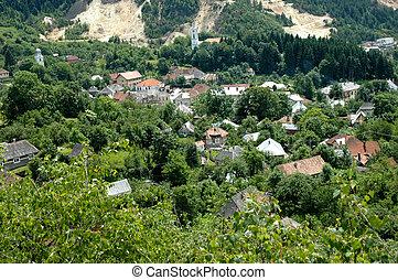 Gold mine against village - Rosia Montana, Romania. The...