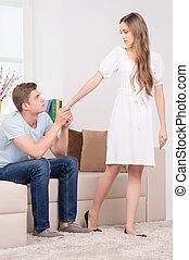 Relationship difficulties Sad young man holding his...