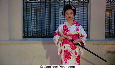 Japanese geisha with sword - Japanese geisha samurai with...