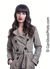 Woman wearing a rain coat - Beautiful young brunette woman...