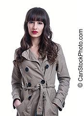 Woman wearing a rain coat - Beautiful young brunette woman...
